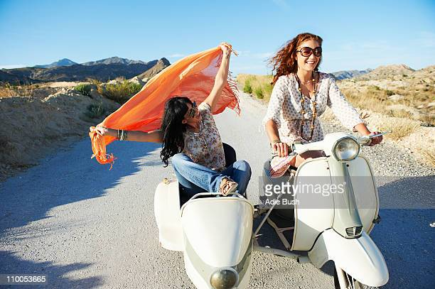 Women driving with motorbike and sidecar