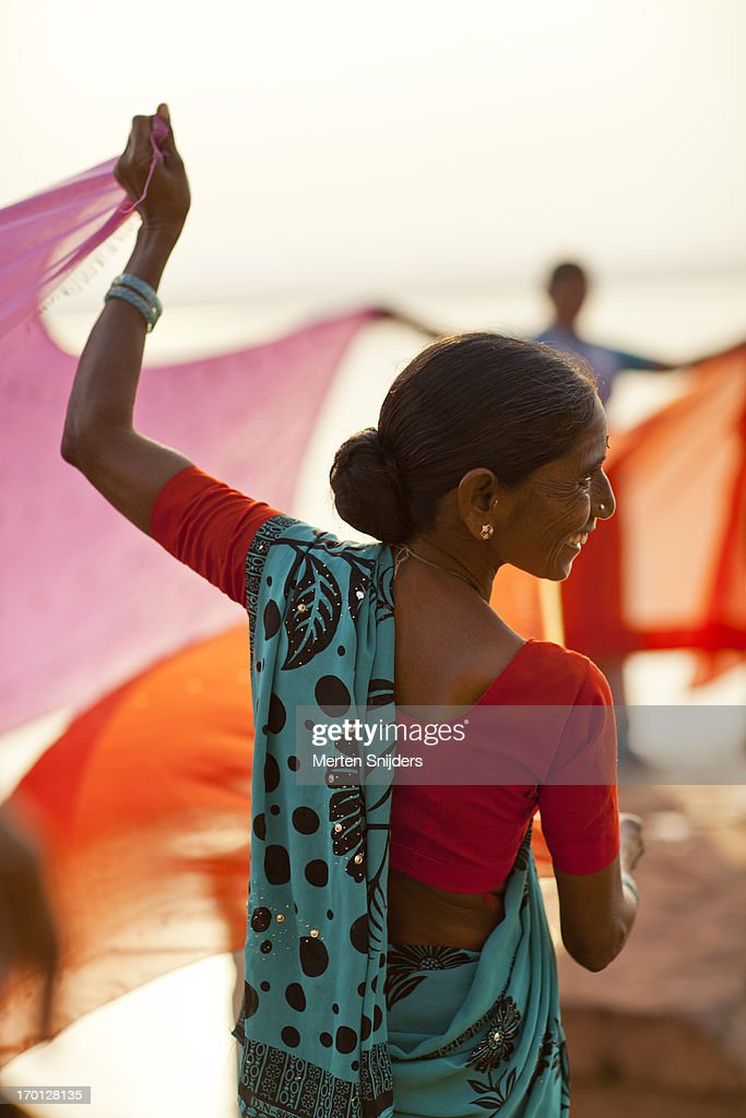 Women drying colorful cloths at ganga