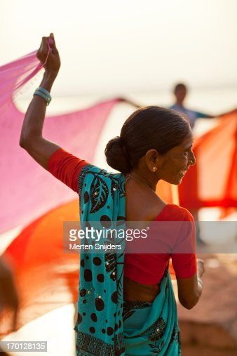 Women drying colorful cloths at ganga