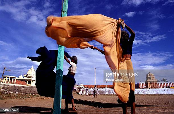 Women drying traditional Sari in the wind after bathing in the sea in Kanyakumari town or Cape Comorin in the state of Tamil Nadu South India