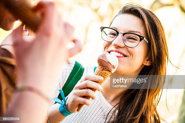 Women eating an ice cream outdoor