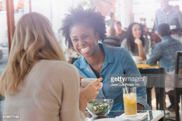 Women eating food in cafe