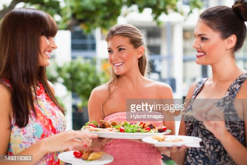 Women eating hors doeurves together