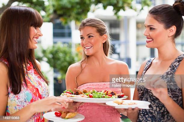 Women eating hors doeurves together