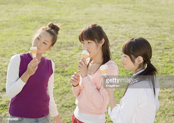 Women eating ice cream cone