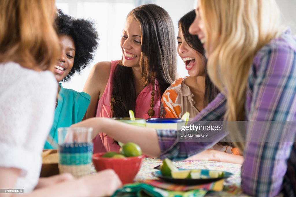 Women eating together at table