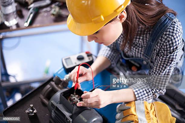 Women electrician working.