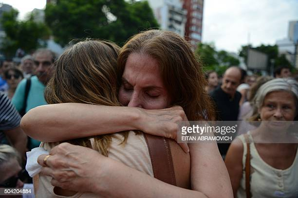 Women embrace during a demo called by Human Rights organizations Abuelas y Madres de Plaza de Mayo and HIJOS at the former Mechanics School of the...
