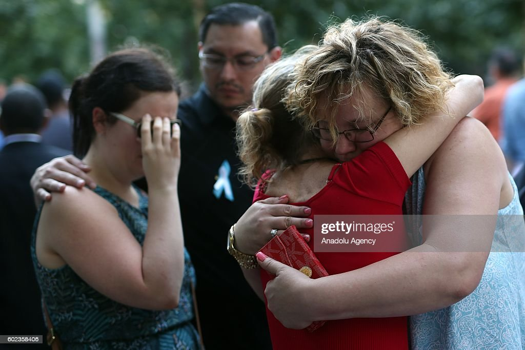 Women embrace each other on the 15th anniversary of the 9/11 in Ground Zero, Manhattan, New York, United States on September 11, 2016.