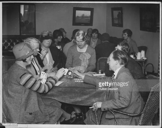 Women enjoy a friendly game of cards at an afternoon bridge party
