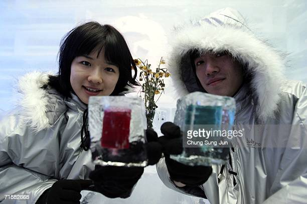 Women enjoy cocktails at 'Icebar SubZero' on August 4 2006 in Seoul South Korea The entrance fee for South Koreas first Ice Bar is 15USD and includes...