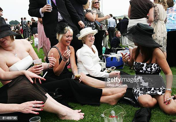 Women enjoy Pimms at a 21st birthday party during Ladies Day at The Derby Festival on June 6 2008 in Epsom England