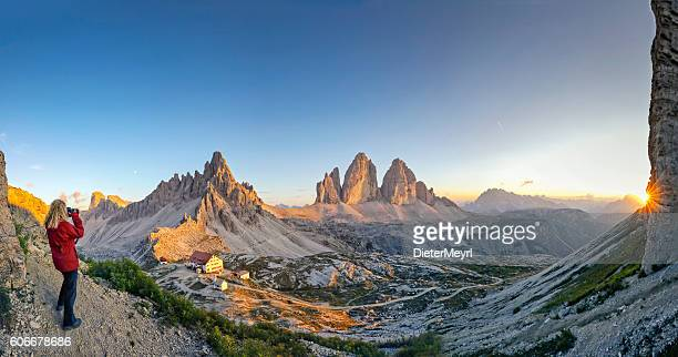 Women enjoy the view  at Tre Cime and take pictures