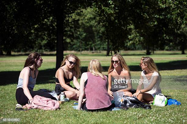 Women enjoy the warm weather in Hyde Park on July 3 2014 in London England Southern England has recorded the highest temperature of the year so far...