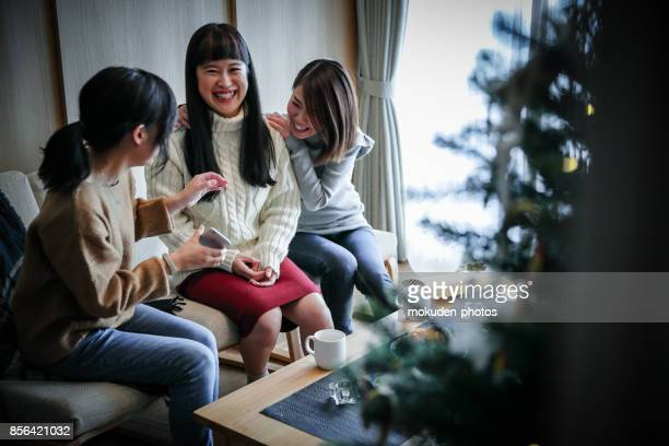 Women enjoying a Christmas party at a friend's house