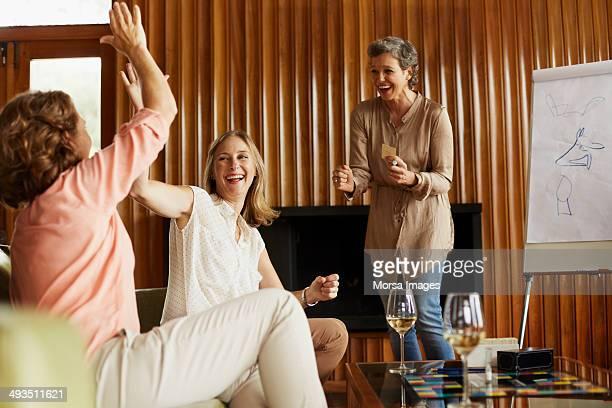 Women enjoying indoor games