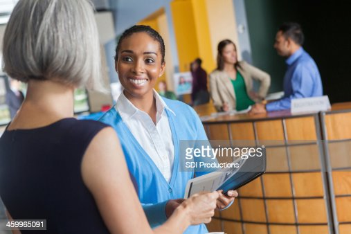 Women exchanging resumes at professional job fair event