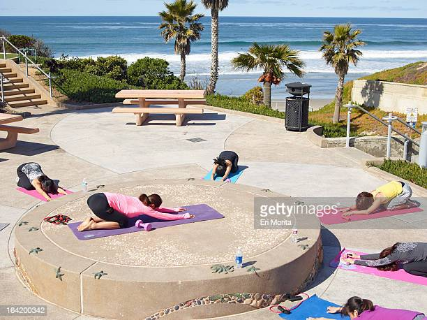 Women exercising at park