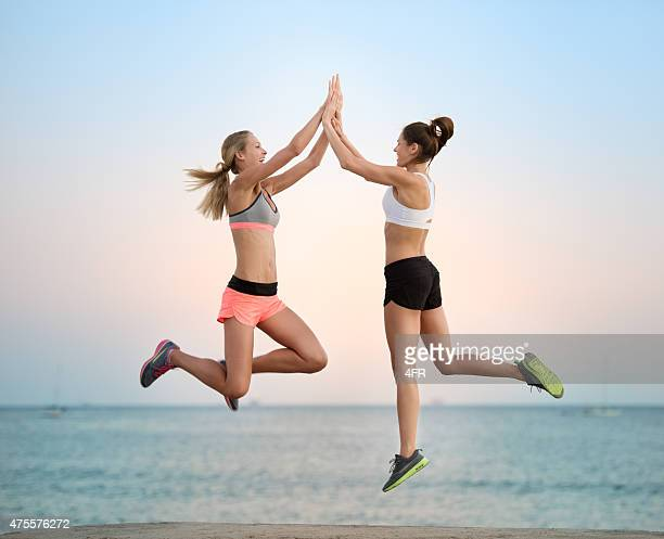 Women exercising at Sunset on the Beach, California, USA