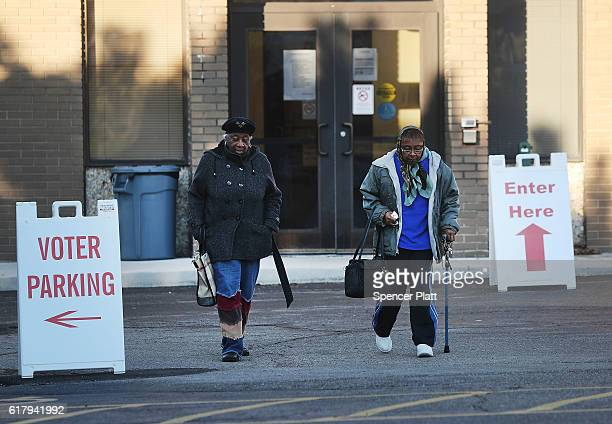 Women exit a voting precinct open for early voting on October 25 2016 in Akron Ohio Ohio has become one of the key battleground states in the 2016...