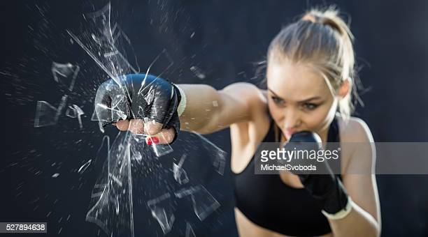 Women Fighter Punching Close Up Glass Shattering