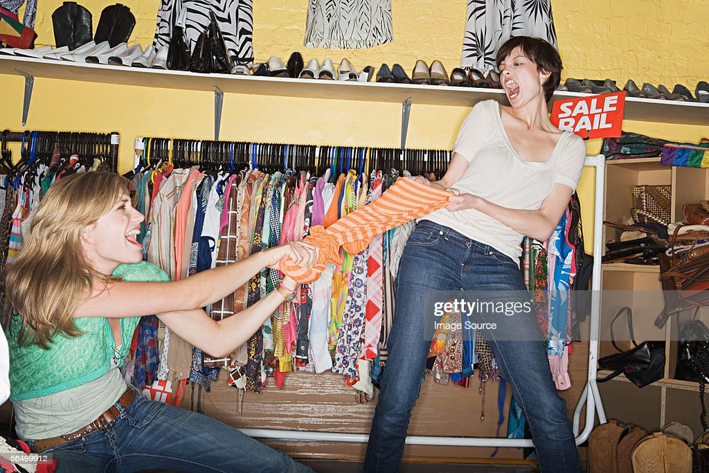 Women fighting at a clothes sale