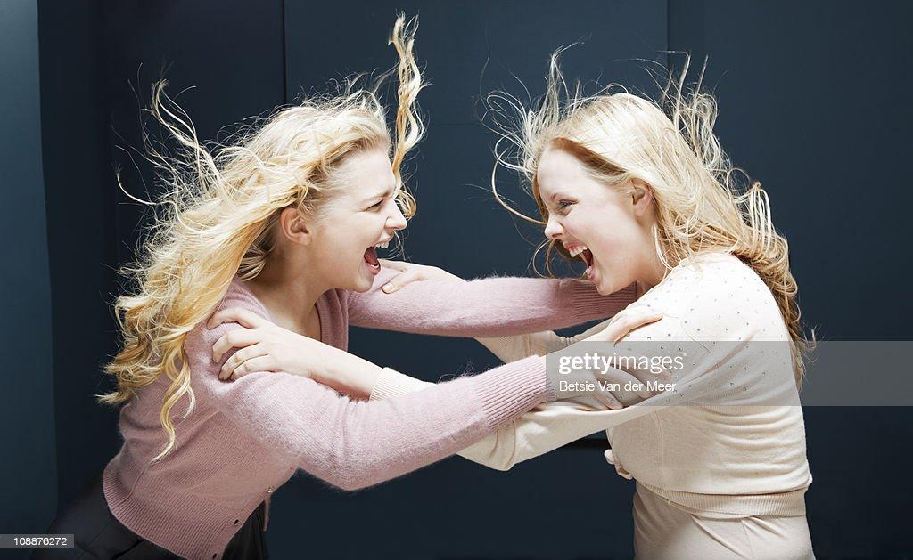 Women fighting eachother.