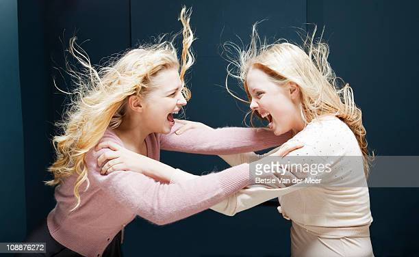 Women fighting eachother.