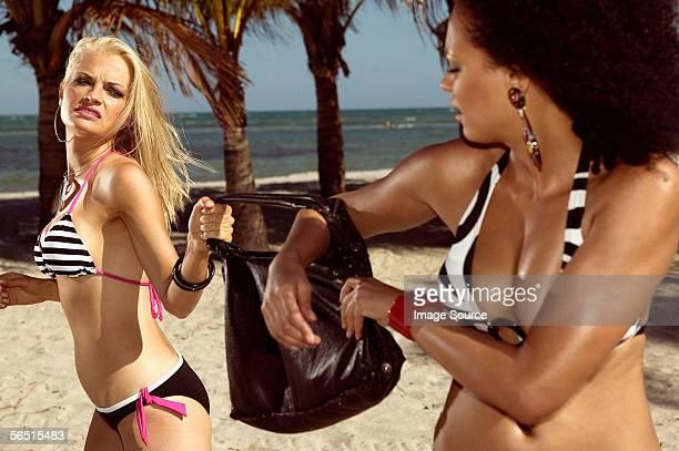 Women fighting over handbag