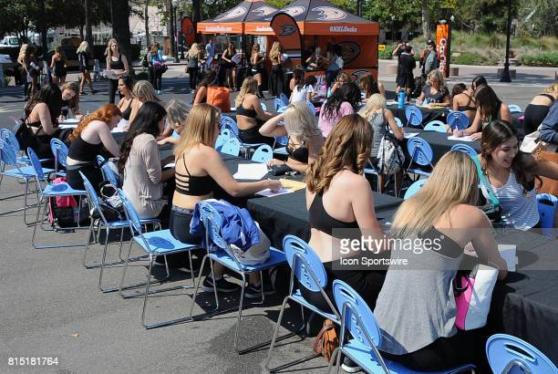 Women filling out paperwork to become a 20172018 Anaheim Ducks Power Player on July 15 2017 outside Anaheim Ice in Anaheim CA