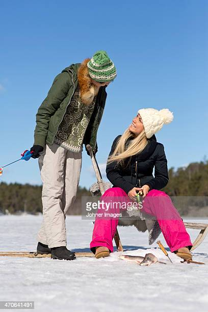 Women fishing at winter