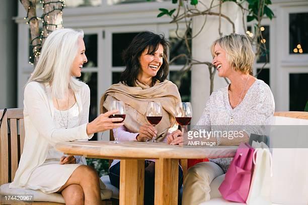 Women friends drinking wine