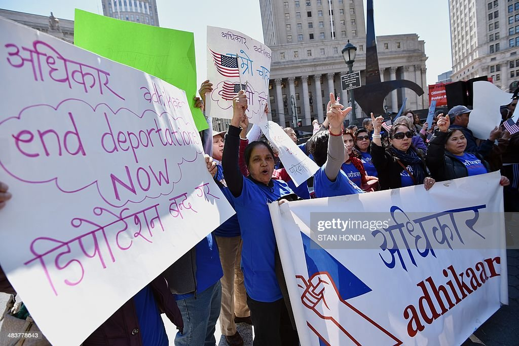 Women from Adhikaar, a Nepalise activist group, join a coalition of New York area groups during a rally to call on Congress to move on immigration reform in Foley Square April 10, 2014 in New York. AFP PHOTO/Stan HONDA