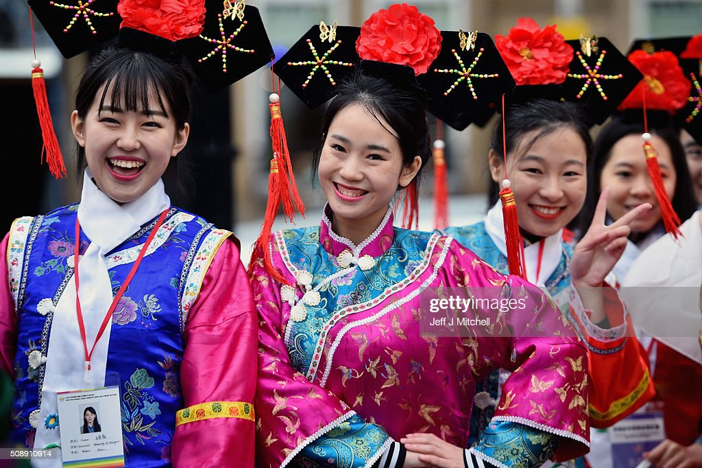 Women from the Chinese community of Glasgow are dressed in traditional costumes celebrate The Year of The Monkey on February 7, 2016 in Glasgow, Scotland. The first ever Chinese New Year celebrations to be held in George Square, The Year of the Monkey begins on February 8th and lasts until January 27, 2017.
