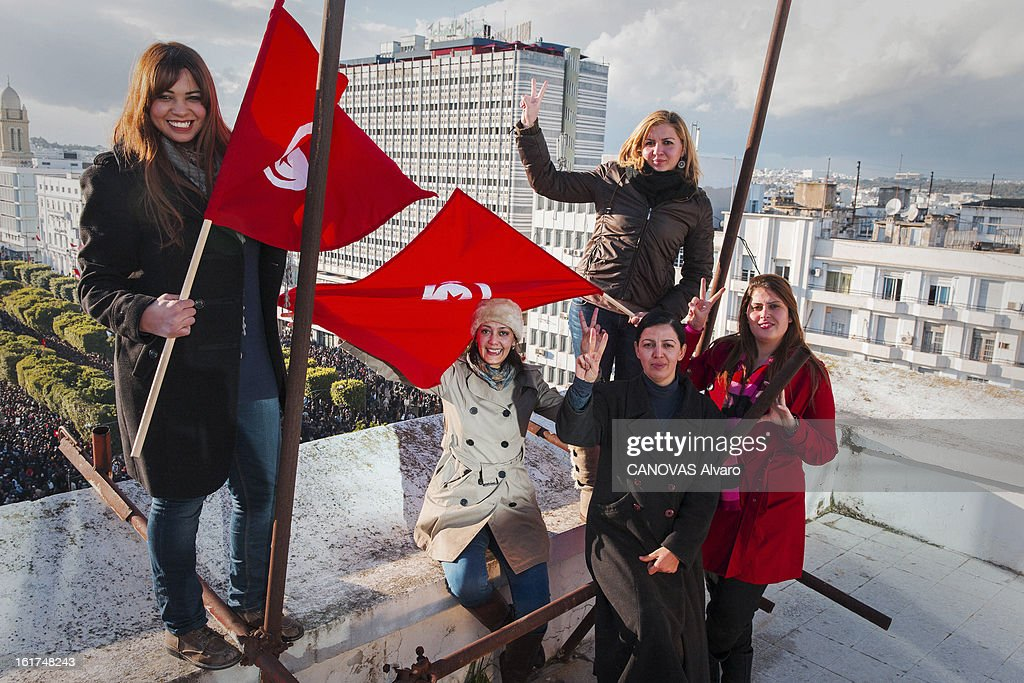 Women from the Republican party posing with Tunisian flags on the roof of the headquarters of the Democratic Movement, an opponent of Ennahda on February 9, 2013 in Tunis,Tunisia.