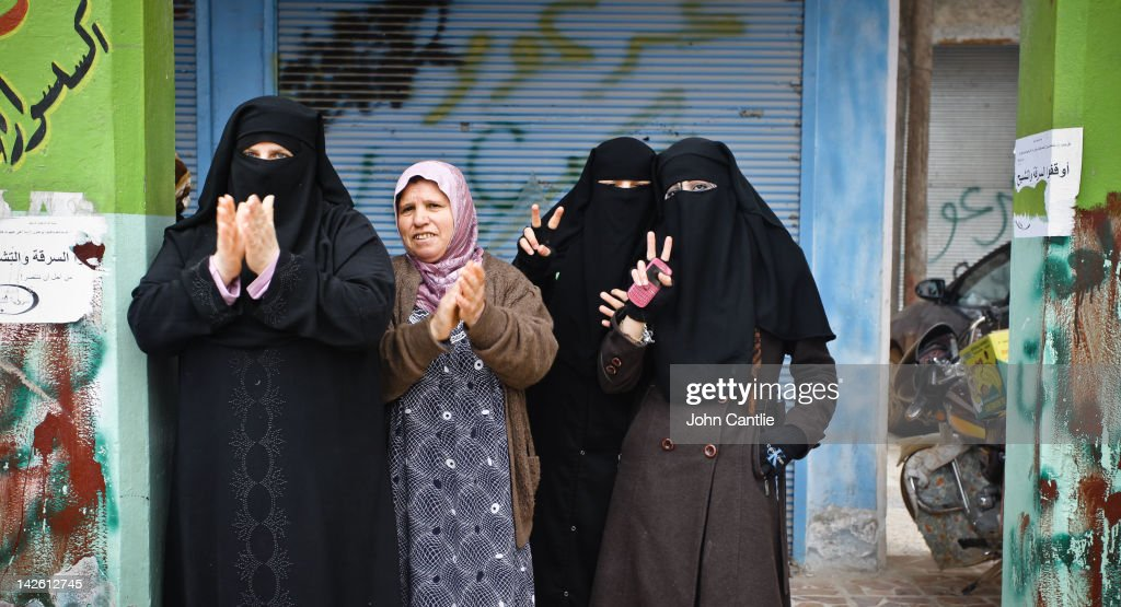 Women gesture during an anti-Assad protest in the town of Binnish on April 9, 2012 in Binnish, Syria. Conitnuing violence in northern Syria between government forces and rebels is putting plans for a UN-brokered Syria ceasefire on Tuesday in jeopardy.