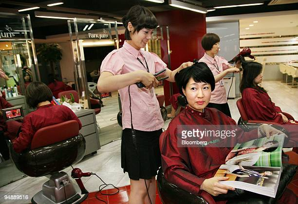 Women get their hair done at a beauty salon in Seoul South Korea on Wednesday May 28 2008 Banks and retailers are rolling out products catering to...