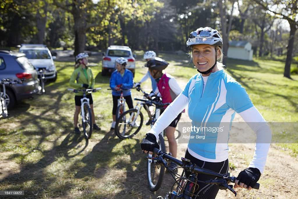 Women going for a bike ride in the countryside : Stock Photo