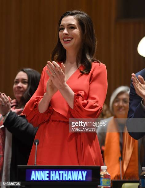 UN Women Goodwill Ambassador Anne Hathaway speaks at the UN International Womens Day commemoration with UN officials gender experts and activists...