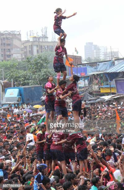 Women Govinda Mandal form human pyramid to break earthen pots on the occasion of Janmashtami at Borivali on August 15 2017 in Mumbai India The...