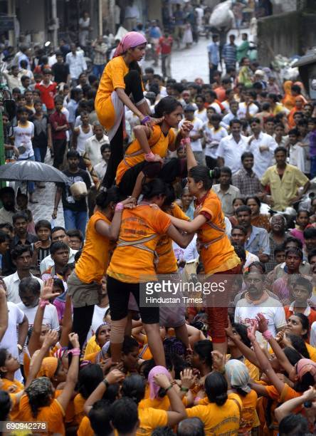Women Govindas of Girgaumcha Raja Mahila Govinda Pathak build tiers to break the Dahi handi of 10th lane in Kamathipura