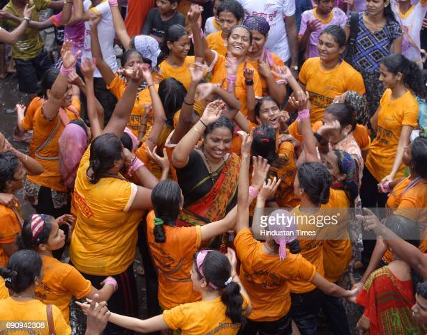 Women Govindas of Girgaumcha Raja Mahila Govinda Pathak dance after breaking the Dahi handi of 10th lane in Kamathipura