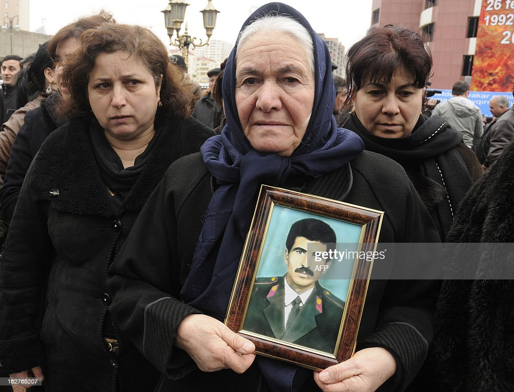 Women grieve at a monument to the victims of what Azerbaijan refers to as the 'Khojaly Massacre' rises in Baku, the capital of Azerbaijan, on February 26, 2013, during a ceremony to mark the 21st anniversary of the tragedy. Azerbaijani authorities say 613 people died when Armenian troops attacked the village of Khojaly in Karabakh in 1992 during Nagorny-Karabakh conflict in what Baku has described as 'genocide', a term fiercely rejected by Yerevan.