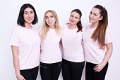 Women group in white t-shirts. Young friends, advertising on clothes, promo campaign, smiling hostesses, friendly team concept