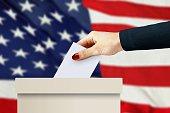women hand casting a vote
