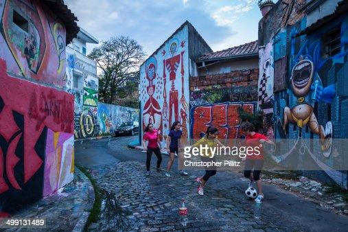 Women have a kickabout on a Sao Paulo city sreet