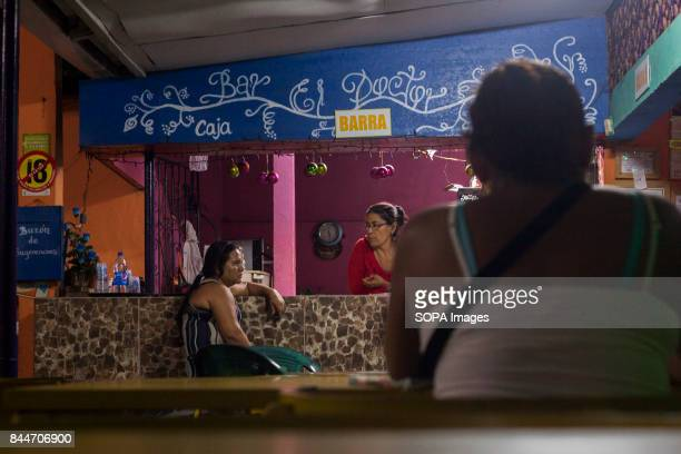 CHICHIGALPA CHINANDEGA NICARAGUA Women having a chat inside a local bar on the Island of Widowed Women a town that is located within the San Antonio...