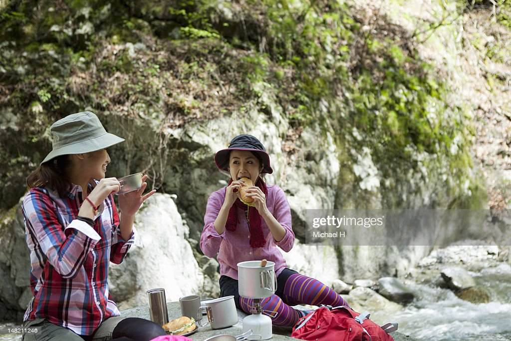 women having a lunch break in the great nature : Stock Photo