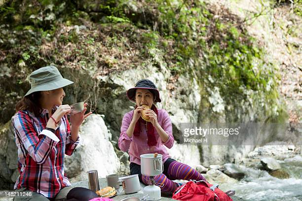 women having a lunch break in the great nature