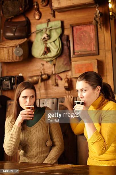 Women having beer in pub